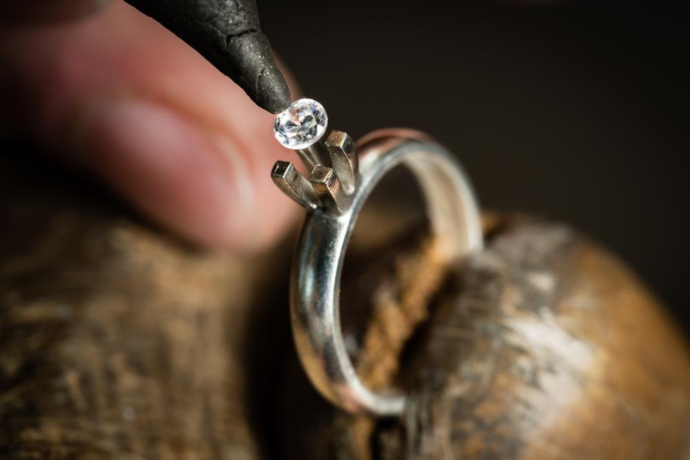 Jeweller crafting a diamond ring