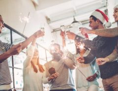 Team cheering their drinks at a corporate Christmas party