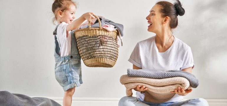 Mum and daughter folding their laundry