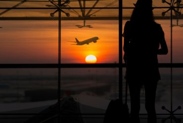 Silhouette of female waiting at the airport