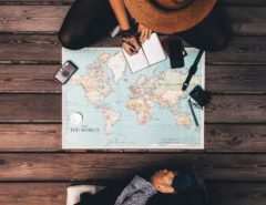 Travelling writer looking at the world map