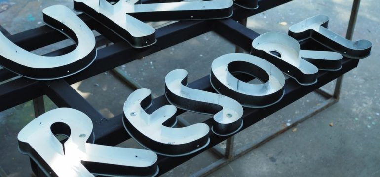 Channel letters being produced before installing onto building