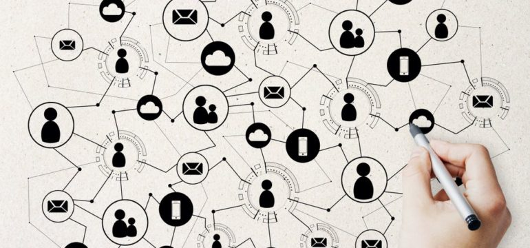 Person drawing icons of social media making connections with humans