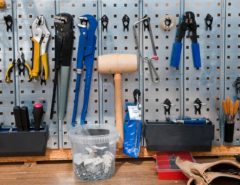 Tools organised on a wall cupboard