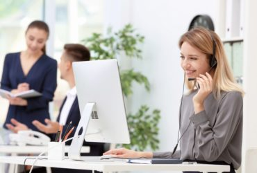 Female receptionist answering call with headset