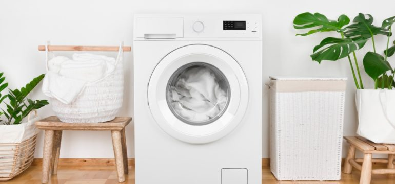 Laundry room with white washing machine and accessories
