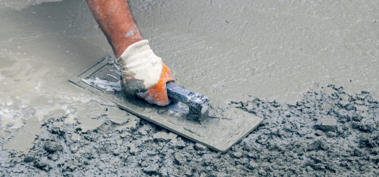 Tradie smoothing concrete slab