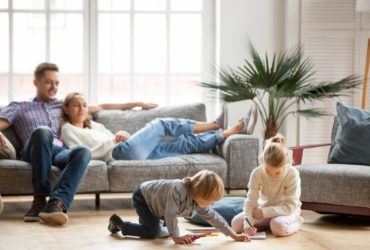 Family of four relaxing in their living room