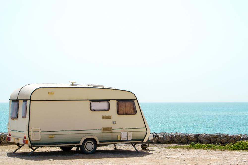 Retro caravan overlooking an ocean view.