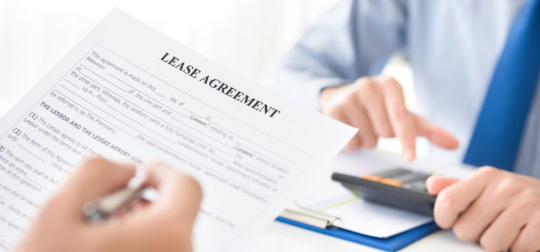 Someone signing a lease agreement