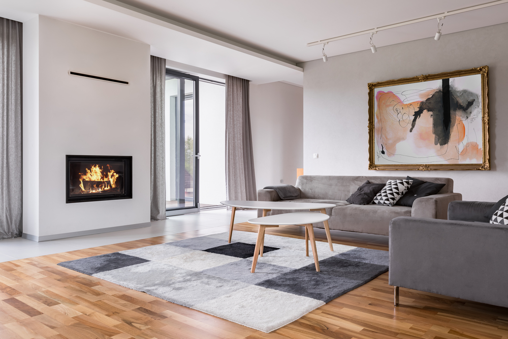 Large lounge room with timber floors and a built in fireplace