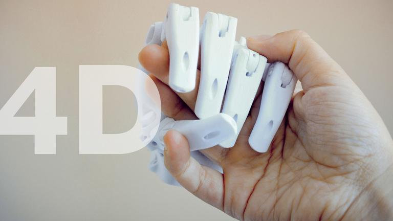 A human hand holding a robot hand