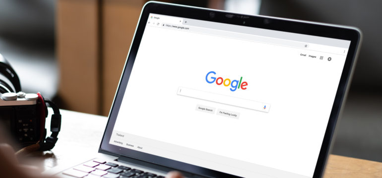 Person on the google homepage on their laptop