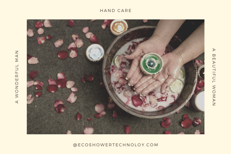 Persons hand in a bowl filled with flower petals and limes