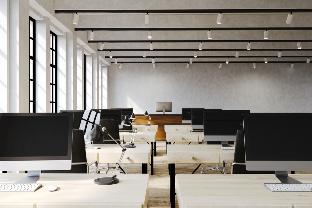 Spacious office with plenty of distance between tables and chairs