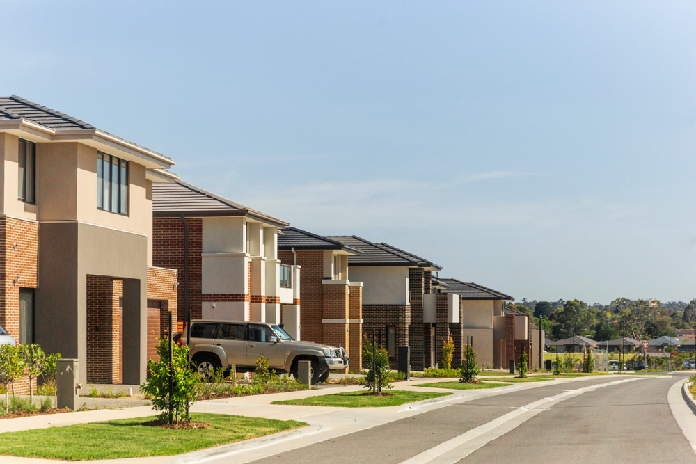 Suburban Australian street showing multiple two storey houses and driveways