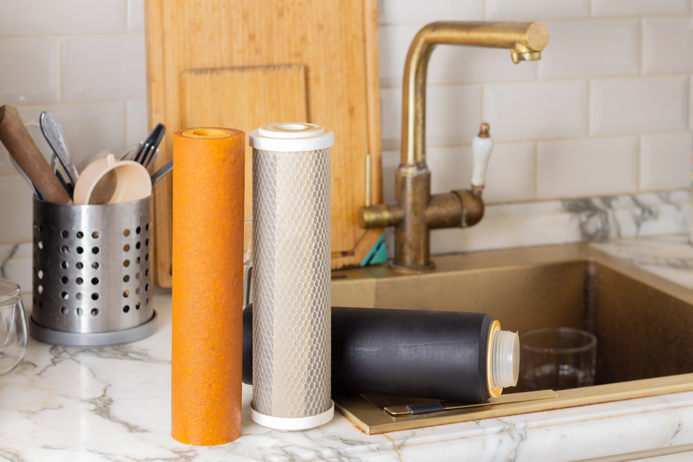 A set of old used filter cartridges on a kitchen benchtop